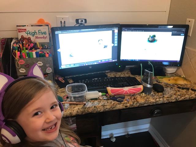Elementary school student, Ella Hulshult, learning online.