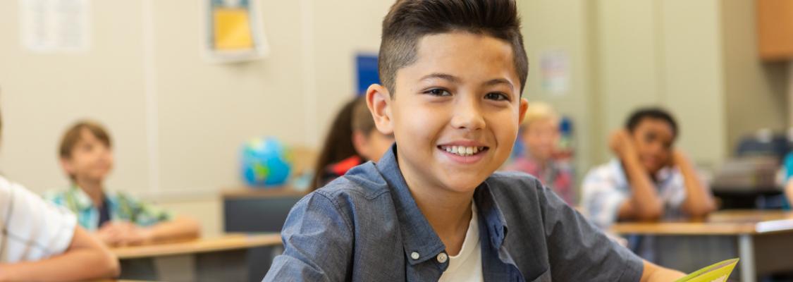 Boy Using Studies Weekly Social Studies Curriculum