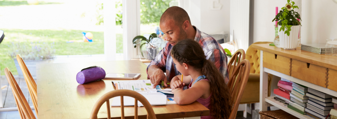 Parent with Student Using Studies Weekly