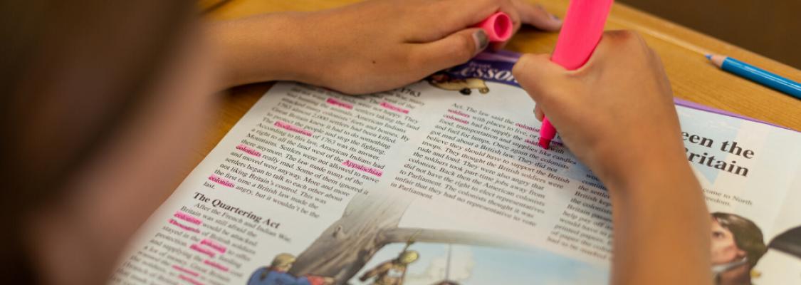 Student highlighting Studies Weekly