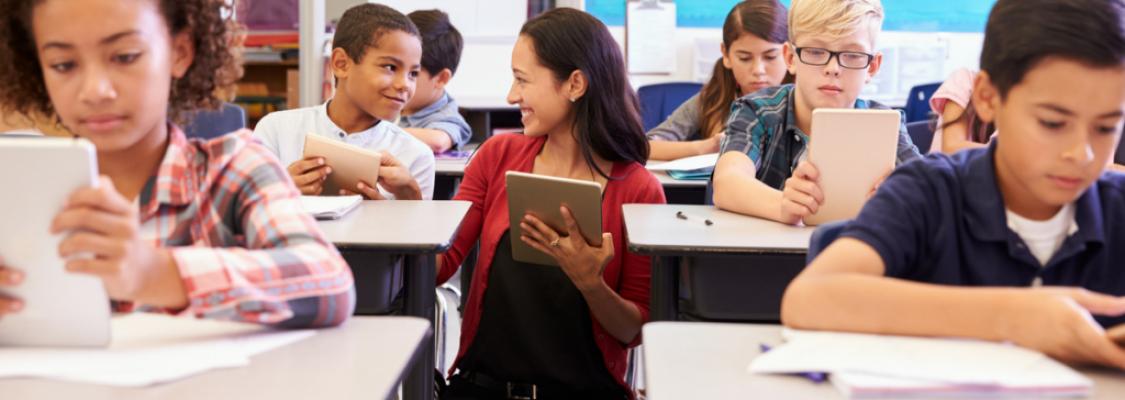 Studies weekly teacher using tablets in classroom